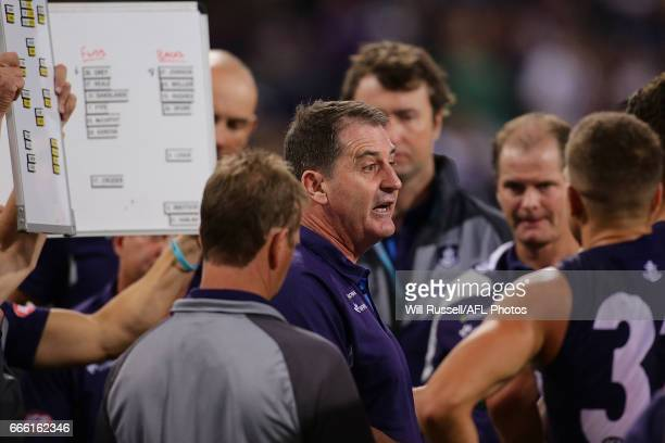 Dockers coach Ross Lyon addresses the players at the quarter time break during the round three AFL match between the Fremantle Dockers and the...