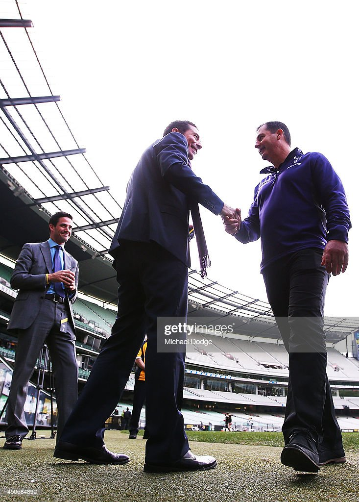 Dockers coach Ross Lyon (R) and a Dockers official shake hands during the round 13 AFL match between the Richmond Tigers and the Fremantle Dockers at Melbourne Cricket Ground on June 14, 2014 in Melbourne, Australia.