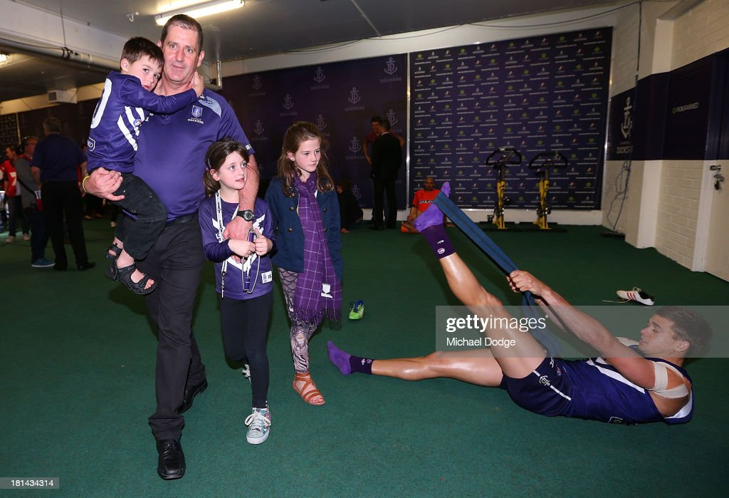 Dockers coach Ross Lyon celebrates the win with his kids while <a gi-track='captionPersonalityLinkClicked' href=/galleries/search?phrase=Stephen+Hill+-+Australian+Rules+Football+Player&family=editorial&specificpeople=9738550 ng-click='$event.stopPropagation()'>Stephen Hill</a> stretches during the AFL Second Preliminary Final match between the Fremantle Dockers and the Sydney Swans at Patersons Stadium on September 21, 2013 in Perth, Australia.