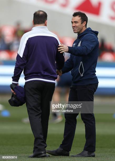 Dockers coach Ross Lyon speaks with Cats coach Chris Scott prior to the round 14 AFL match between the Geelong Cats and the Fremantle Dockers at...