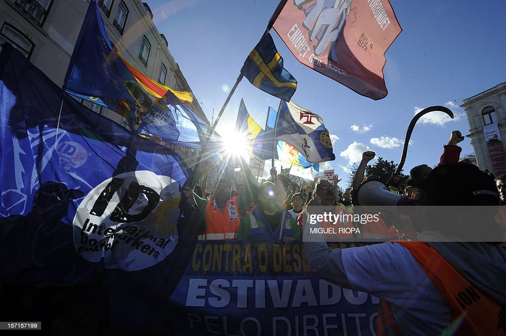 Dockers demonstrate in front of the Portuguese Parliament on November 29, 2012 in Lisbon. Dockers of Lisbon harbour have been on strike for two months in protest against the reform of their working arrangements currently under discussion by the government. AFP PHOTO / MIGUEL RIOPA