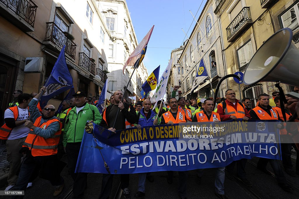 Dockers demonstrate on November 29, 2012 in Lisbon. Dockers of Lisbon harbour have been on strike for two months in protest against the reform of their working arrangements currently under discussion by the government.