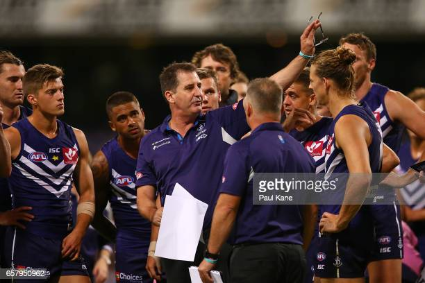 Dockers head coach Ross Lyon addresses his players at the three quarter time break during the round one AFL match between the Fremantle Dockers and...