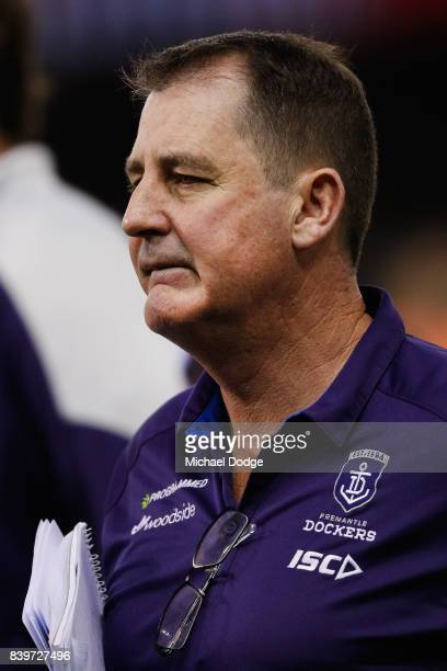 Dockers head coach Ross Lyon alks off during the round 23 AFL match between the Essendon Bombers and the Fremantle Dockers at Etihad Stadium on...