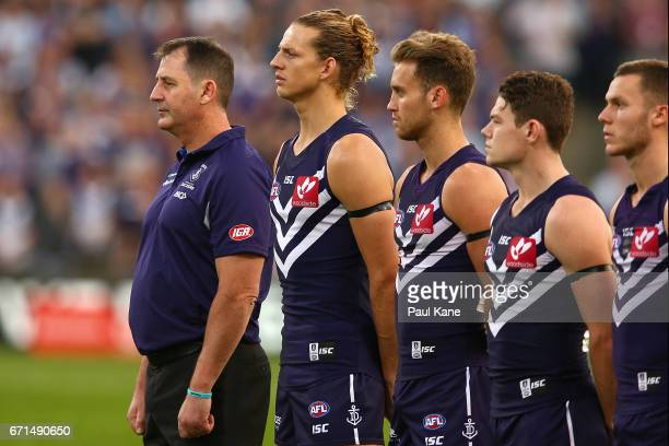 Dockers head coach Ross Lyon and Nathan Fyfe look on during the ANZAC service during the round five AFL match between the Fremantle Dockers and the...