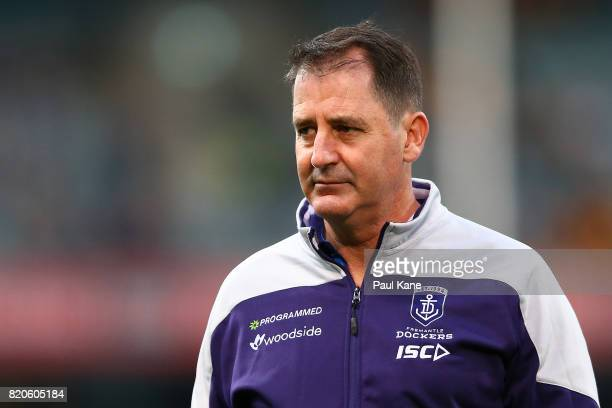 Dockers head coach Ross Lyon looks on while players warm up during the round 18 AFL match between the Fremantle Dockers and the Hawthorn Hawks at...