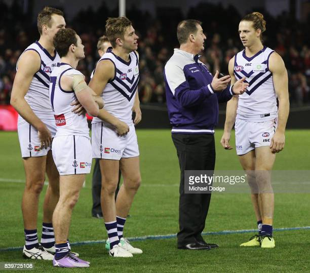 Dockers head coach Ross Lyon talks to Nat Fyfe of the Dockers after their defeat during the round 23 AFL match between the Essendon Bombers and the...