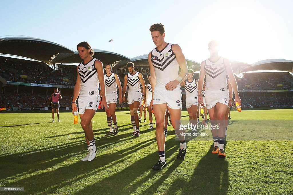 Dockers players come from the field after losing the round six AFL match between the Adelaide Crows and the Fremantle Dockers at Adelaide Oval on April 30, 2016 in Adelaide, Australia.