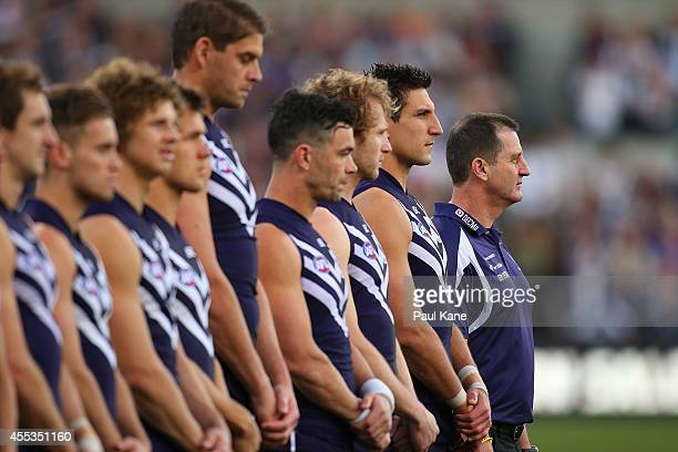 Dockers players line up for the Australian national anthem during the AFL 1st Semi Final match between the Fremantle Dockers and the Port Adelaide...