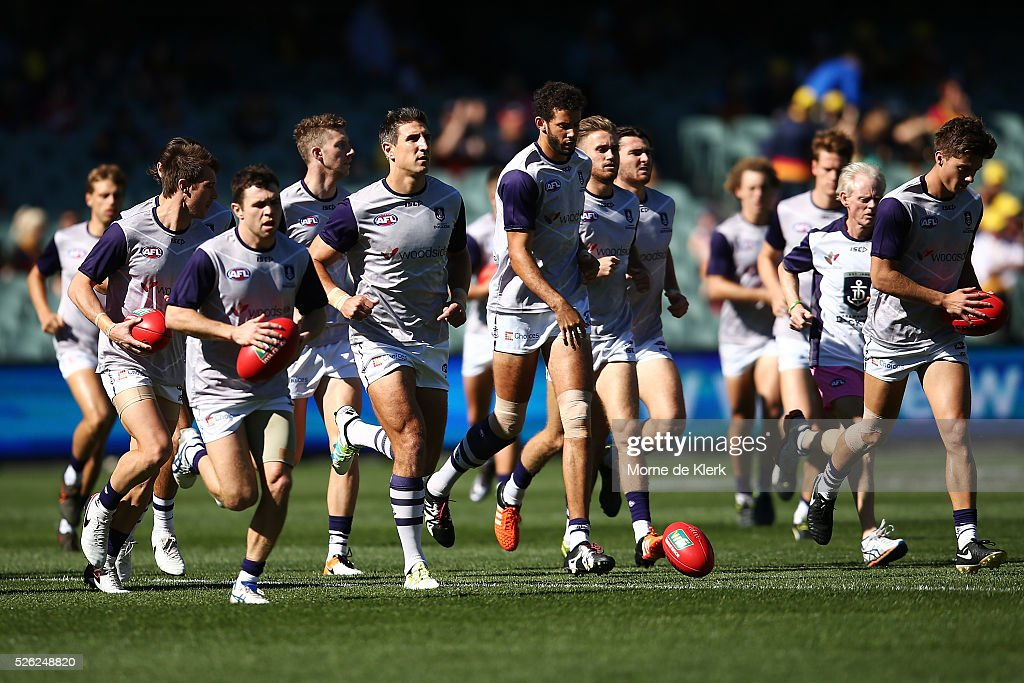 Dockers players warm up before the round six AFL match between the Adelaide Crows and the Fremantle Dockers at Adelaide Oval on April 30, 2016 in Adelaide, Australia.