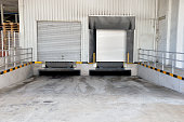 Doors for unloading goods from transport trucks at a center logistic