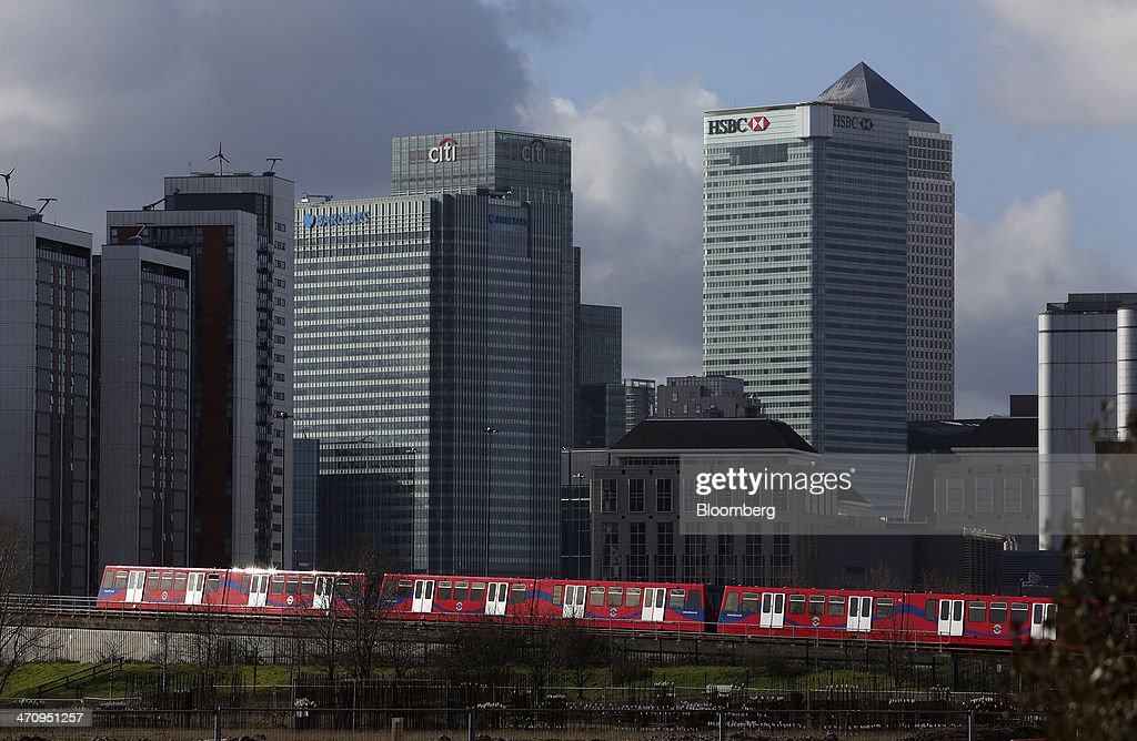 A Docklands Light Railway train travels past the offices of Barclays Plc Citigroup Inc HSBC Holdings Plc and One Canada Square in the Canary Wharf...