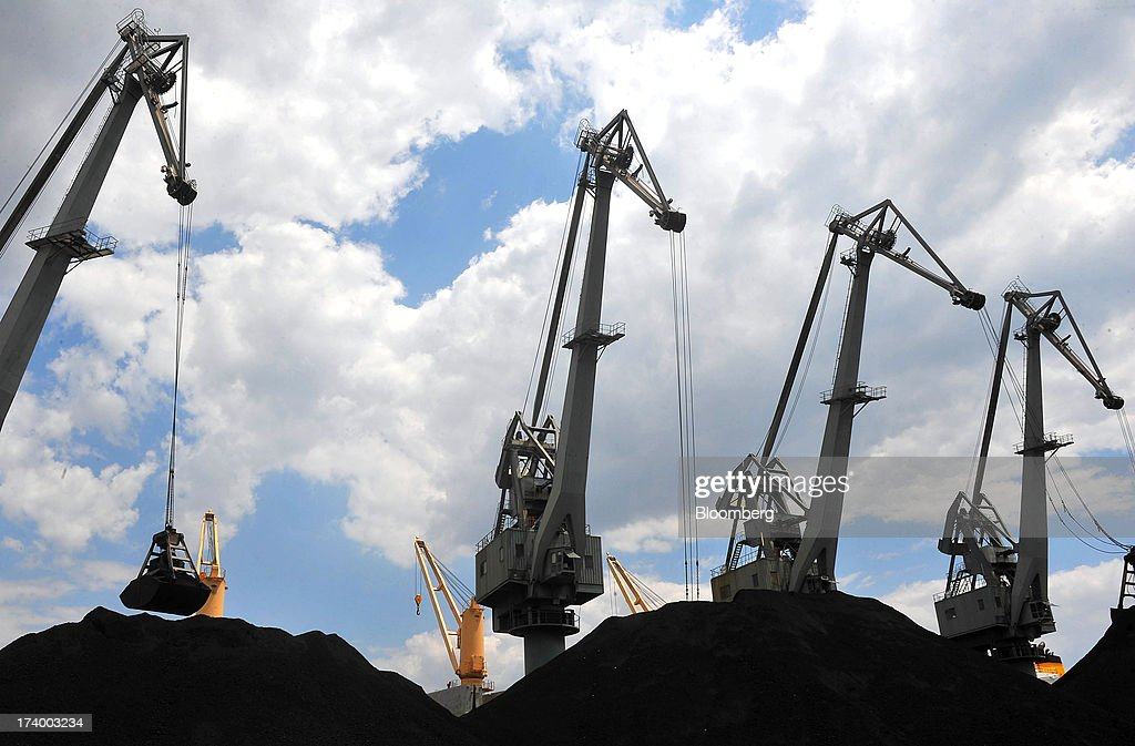 Dockside cranes unload coal from the 'Coral Ace' cargo ship at Thessaloniki Port, operated by Thessaloniki Port Authority SA, in Thessaloniki, Greece, on Thursday, July 18, 2013. Russian Railways is interested in buying Thessaloniki Port and Greek rail operator Trainose SA as one single unit, newspaper Real News reported, citing an interview with the Russian company's CEO Vladimir Yakunin. Photographer: Oliver Bunic/Bloomberg via Getty Images