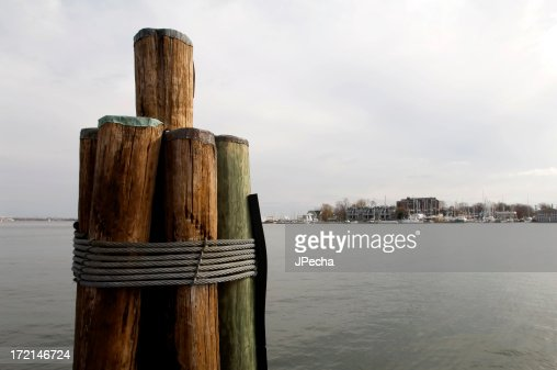Dockside Wooden Pier Pilings Over Harbor