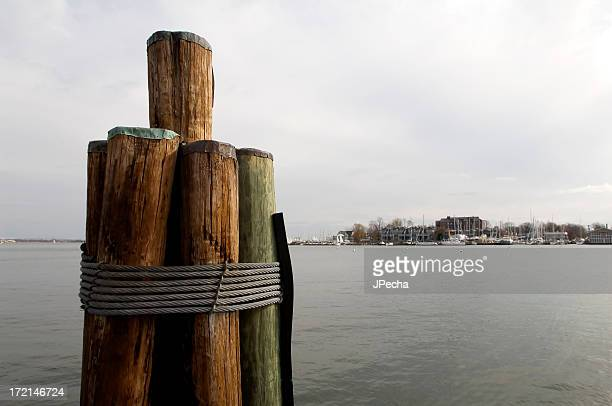 Dockside Wooden Pier Pilings Over Harbor