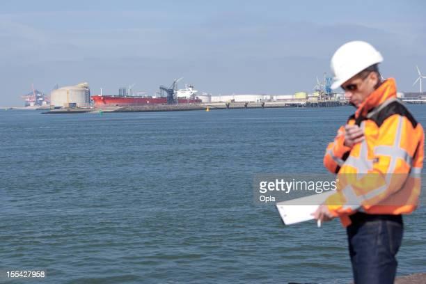 Dockworker giving instructions