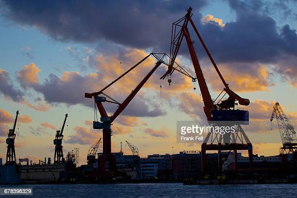 Dockyard cranes at sunset, Gothenburg, Sweden, Scandinavia, Europe