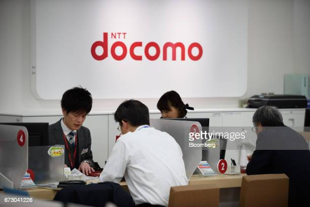 NTT Docomo Inc employees consult with customers at a store in Tokyo Japan on Monday April 24 2017 NTT Docomo one of the world's largest wireless...