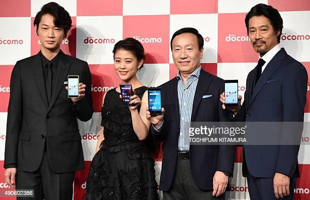NTT DoCoMo president and CEO Kaoru Kato poses with the company's brand ambassadors Go Ayano Mitsuki Takahata and Shinichi Tsutsumi during a press...