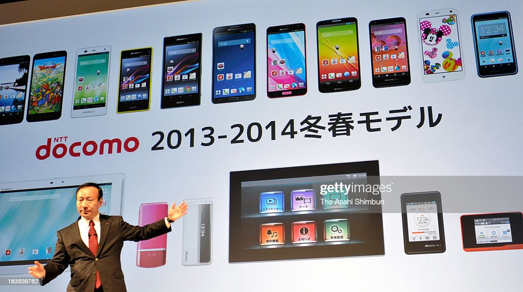 NTT docomo president Kaoru Kato introduces the line-up of its new mobiles during its revealing press conference on October 10, 2013 in Tokyo, Japan.