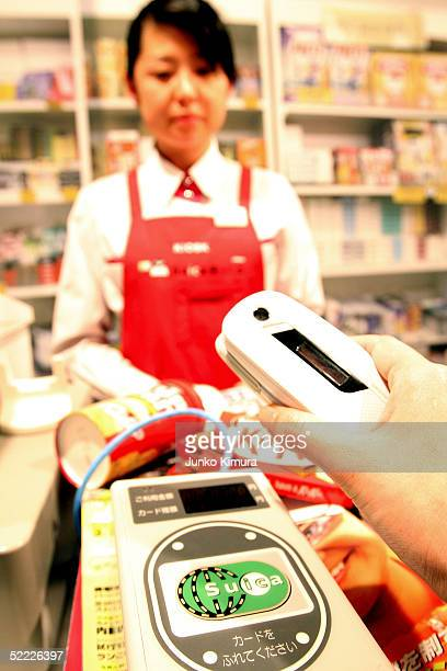 DoCoMo's mobile phone is placed on a reader to pay at a kiosk during a press conference on February 22 2005 in Tokyo Japan East Japan Railway NTT...