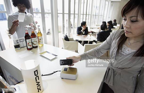DoCoMo's phone based credit card is placed on a reader at a cafe on April 28 2006 in Tokyo Japan The Japanese communications carrier launches its...