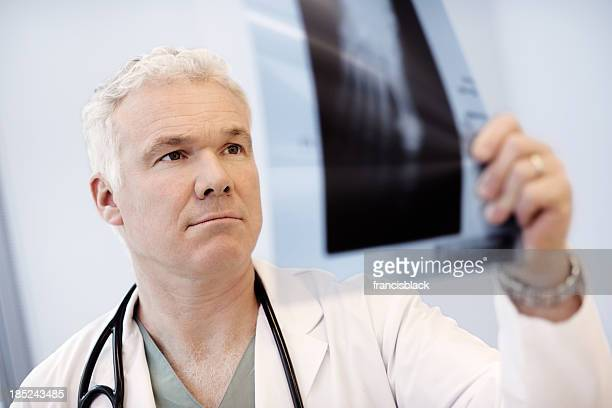 Doctor analyzing an x-ray image of a foot.