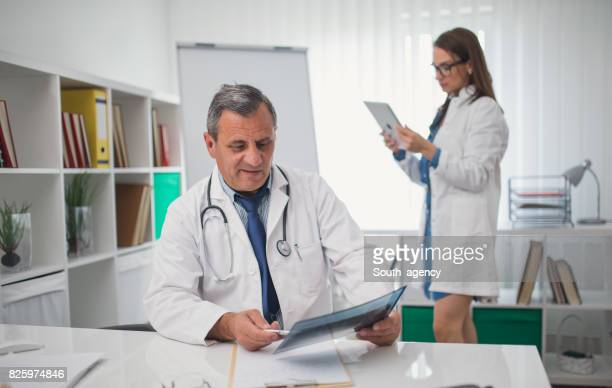 Doctor and assistant
