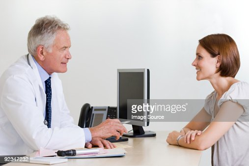 Doctor and female patient : Stock Photo