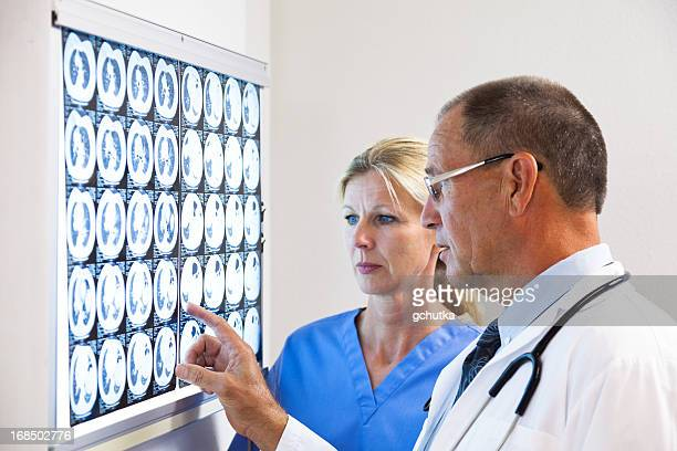 Doctor And Nurse Consulting On X-Ray