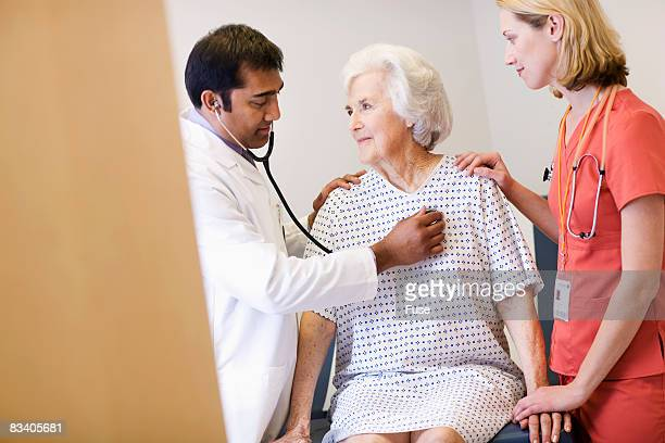 Doctor and Nurse Examining Elderly Woman