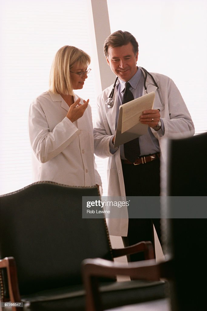 Doctor and Nurse looking at chart : Stock Photo