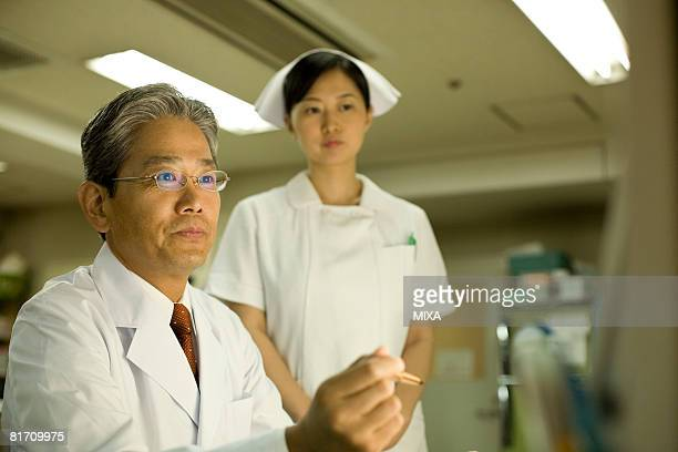 Doctor and nurse looking at monitor