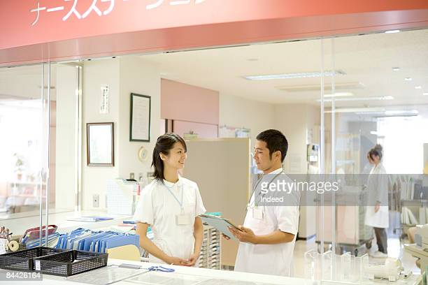Doctor and nurse talking in nurse station