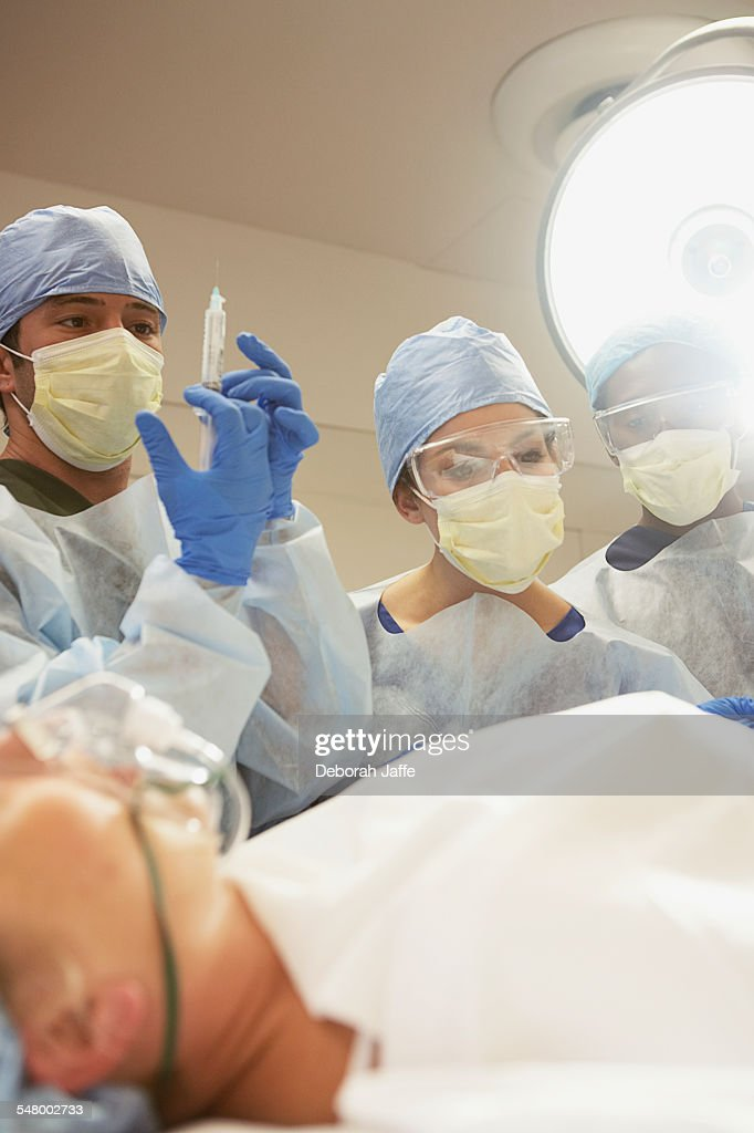 Doctor and nurses in surgery : Stock Photo