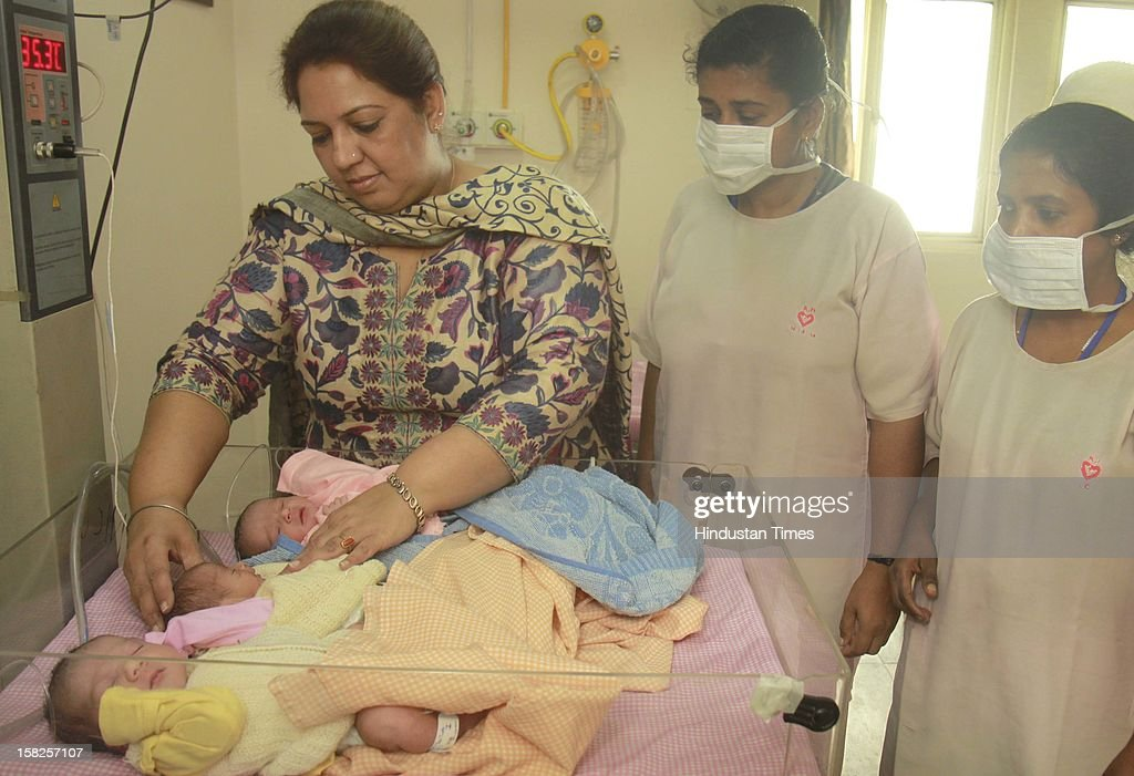 Doctor and nurses tending to Triplet Babies one girl and two boys born to Asha and Ravi Thukral at Kalra Hospital on December 12, 2012 in New Delhi, India. The birth of triplet become special due to their unique birth date of 12.12.12 that is considered lucky by many numerologists.