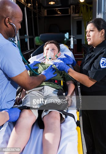 Doctor and paramedic helping child
