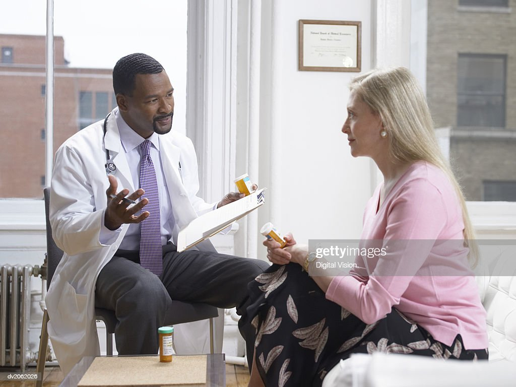 Doctor and Patient Discussing Medication : Stock Photo
