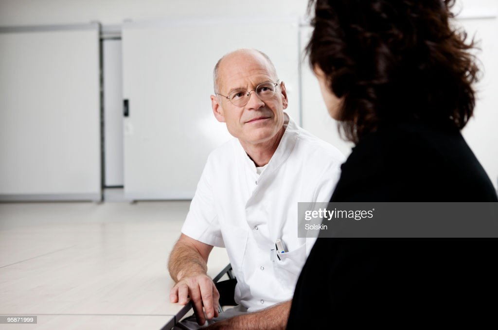 Doctor and patient in conversation : Stock Photo