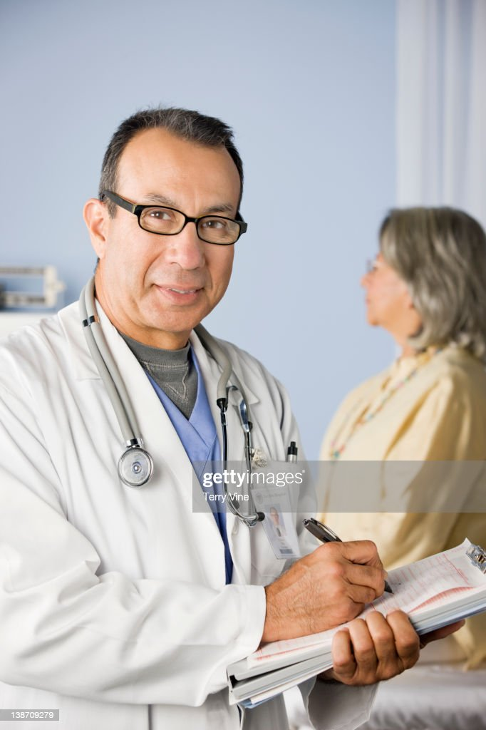 Doctor and patient in examination room : Stock Photo