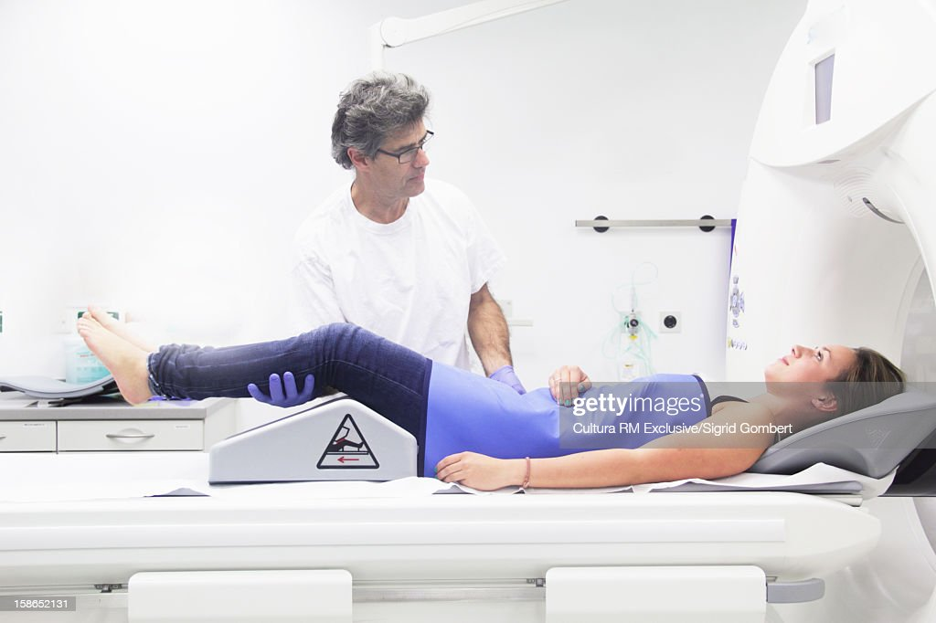 Doctor and patient in radiology lab : Stock Photo