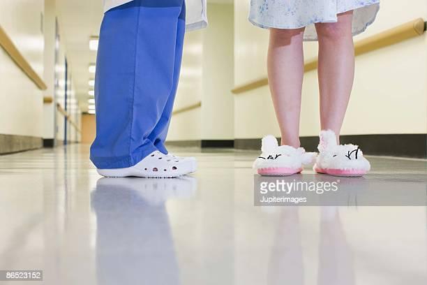 Doctor and patient standing in hallway