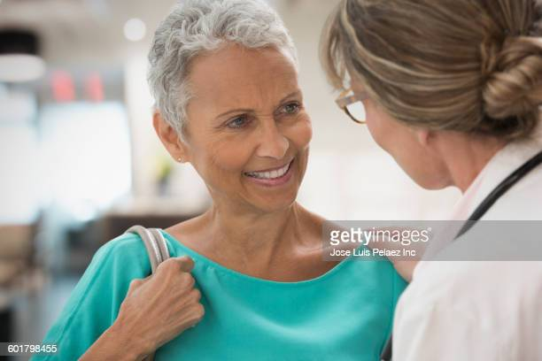 Doctor and patient talking in hospital