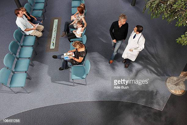 Doctor and patients in waiting area