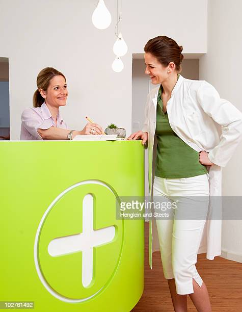 Doctor and receptionist in surgery