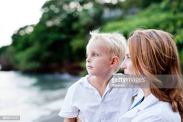 Doctor and son admiring ocean