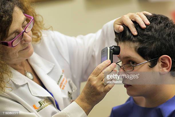 Doctor Antonella Tosti Dermatologist University of Miami School of Medicine uses an iphone as a dermatoscope as she examines Michael Casa Nova for...
