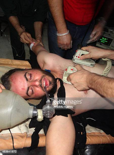 A doctor applies defibrillation on a patient affected by the chlorine gas attack in the Arbin town of Damascus Syria on August 11 2015 Assad regime...
