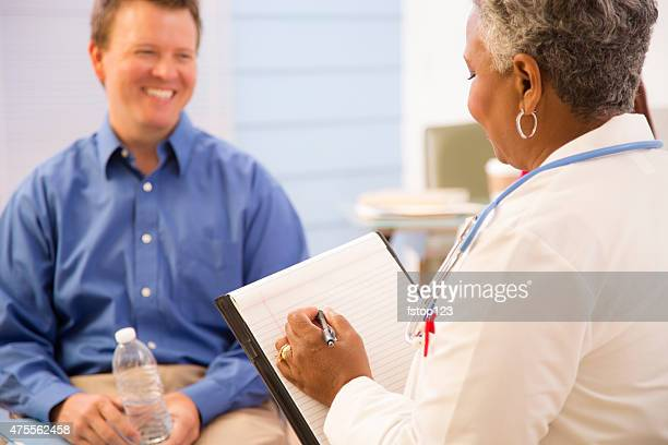 Doctor appointment with mid-adult man patient. Therapy, consultation.