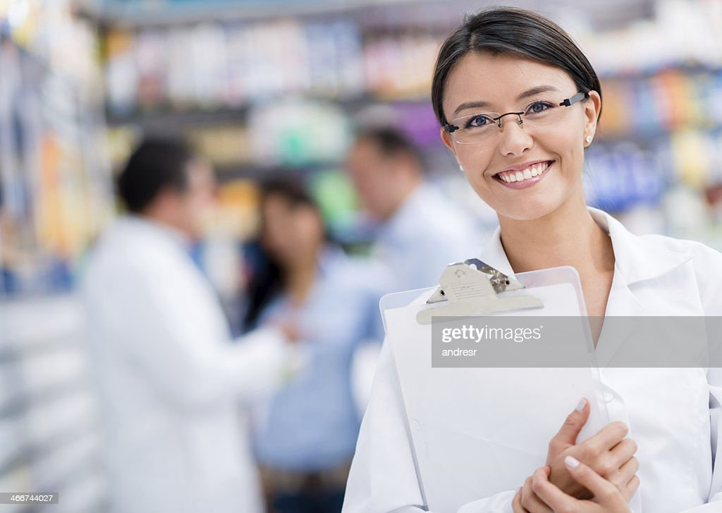 Doctor at the drugstore : Stock Photo